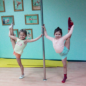 children on the  pole